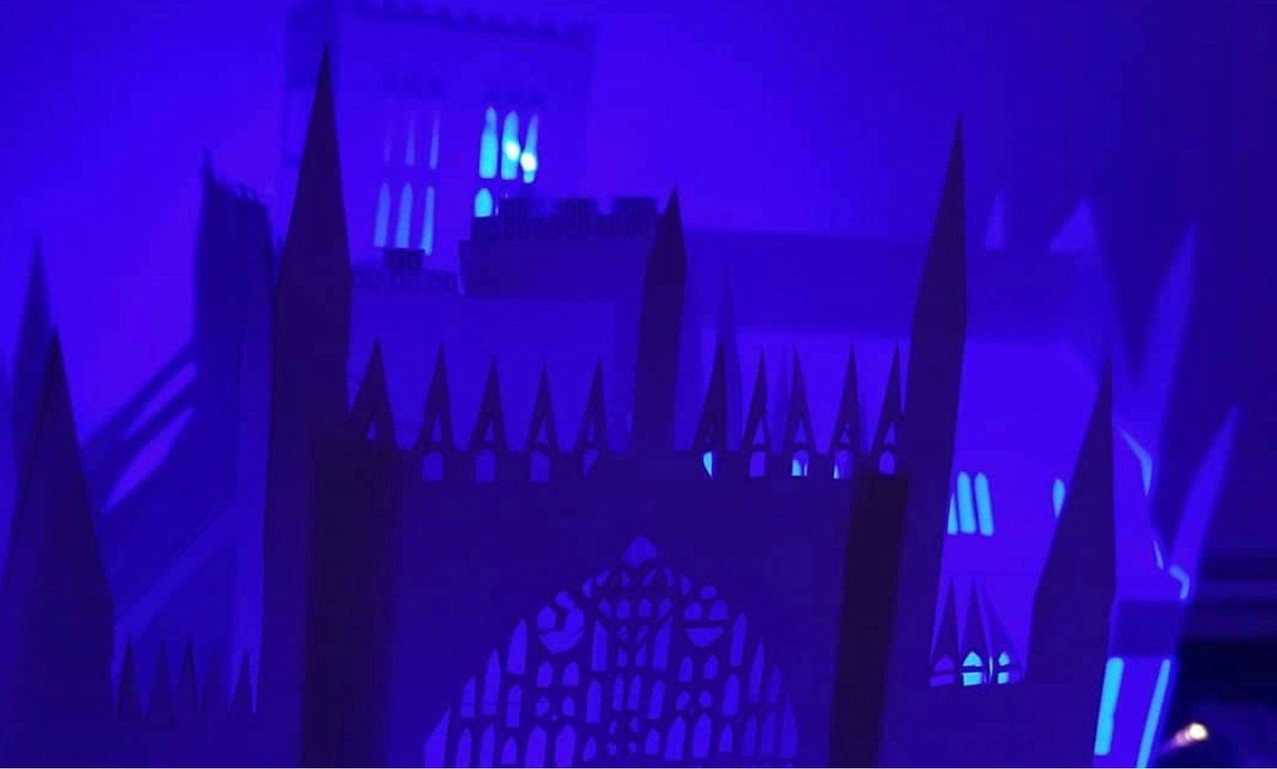 An image of a paper model of York Minster at night in a purple glow.